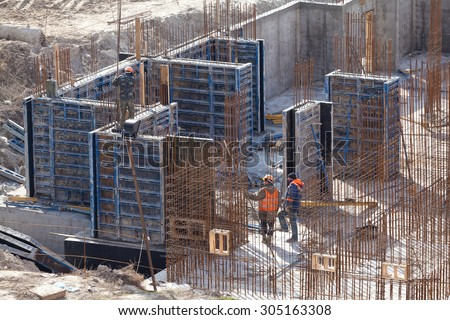 Monolithic frame construction of the building. Solid walls of concrete. The framework for the walls. Formwork for walls made of concrete. Construction of the building.  - stock photo