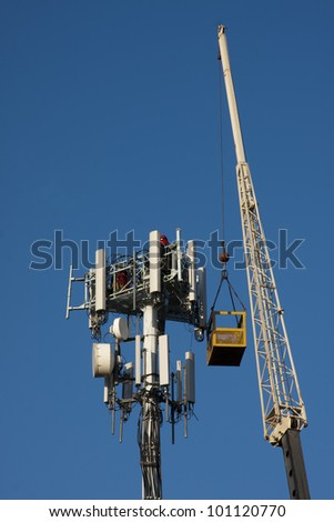 Monotower cellular installation with workers present - stock photo