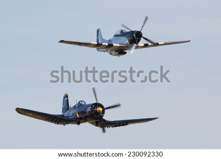 MONROE, NC - NOVEMBER 8, 2014:  A Corsair and P-51 Mustang Fighter Performing at the Warbirds Over Monroe Air Show in Monroe, NC.
