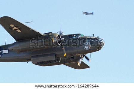 MONROE, NC - NOVEMBER 10:  World War II B-25 Mitchell Bomber Performing during Warbirds Over Monroe Air Show in Monroe, NC, on November 10, 2013.