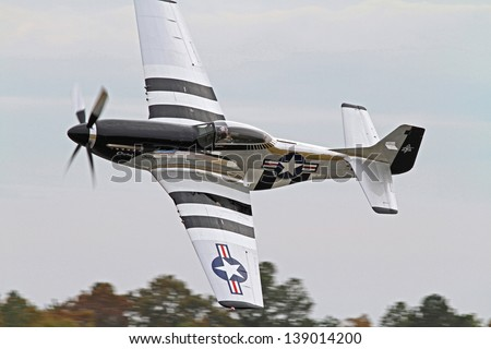 MONROE, NC - NOVEMBER 4: World War II P-51 Mustang Fighter Performing during Warbirds Over Monroe Air Show in Monroe, NC, on November 4, 2012. - stock photo