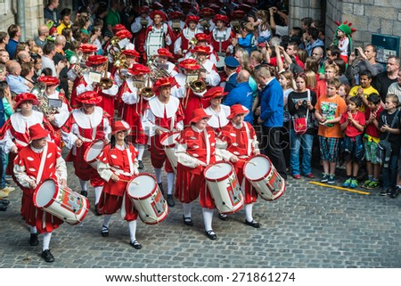MONS, BELGIUM - JUNE 14, 2014: Waltrudeâ??s Shrine Procession within The Ducasse de Mons (Doudou) celebrations, recognized as one of the Masterpieces of the Oral and Intangible Heritage of Humanity. - stock photo