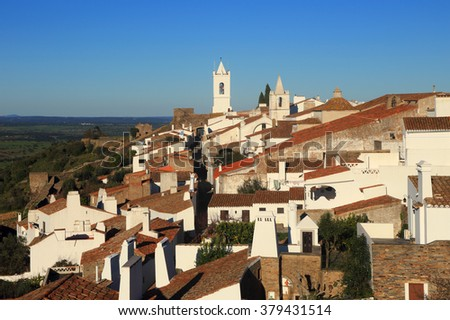 Monsaraz, Evora, Alentejo Region, Portugal. The historical hilltop fortified town in the late afternoon sunshine. - stock photo