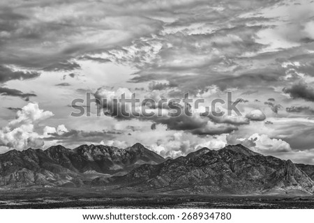 Monsoon clouds forming around arizona  mountain in summer - stock photo