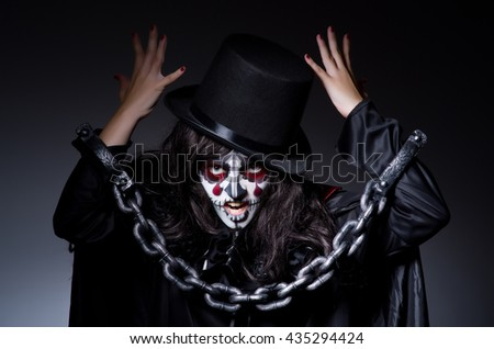 Monster chained in dark room - stock photo