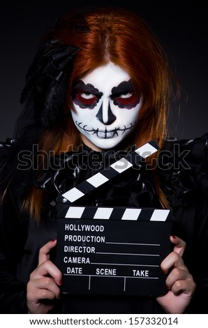 Monster with movie clapper board - stock photo