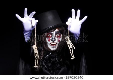 Monster with skeleton in dark room - stock photo