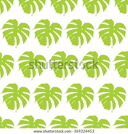 Monstera silhouettes seamless pattern.Tropical leaves.