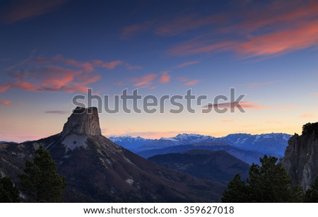 Mont Aiguille in the French Vercors during a tranquil sunrise in december. - stock photo