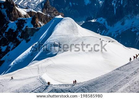 Mont Blanc, Chamonix, French Alps. France. - tourists climbing up the mountain - stock photo