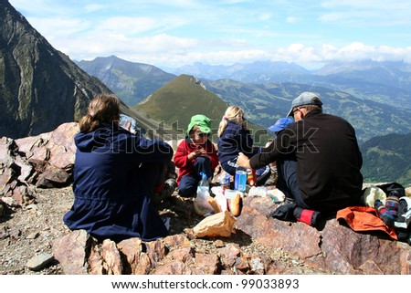 MONT BLANC, FRANCE - AUGUST 25: Family doing a picnic Nid d'Aigle at 2386 meters on August 25, 2006 in Chamonix, France. Nid d'Aigle Station is end of the Mont Blanc tramway.