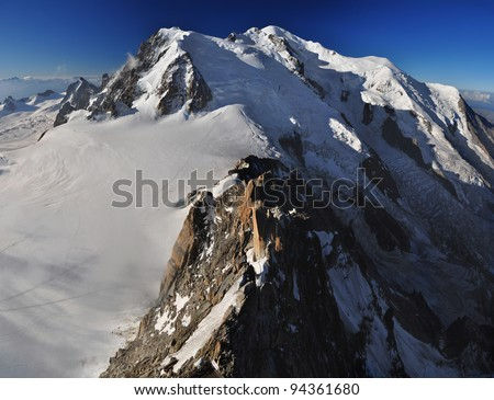 "Mont Blanc (French) or Monte Bianco (Italian), meaning ""White Mountain"", is the highest mountain in the Alps, Western Europe and the European Union."