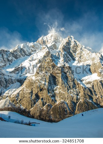 Mont Blanc (Monte Bianco) mountain peak in Alps, highest point of Europe (4810 m), view from Italian side, from Courmayeur ski resort, Valle d'Aosta province - stock photo