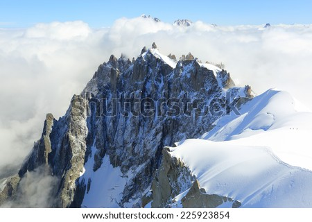 Mont Blanc mountain peak above low clouds