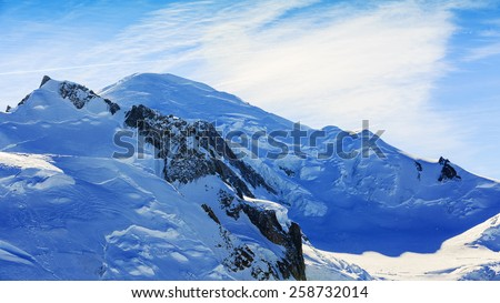 Mont Blanc over Chamonix, view from Aiguille du Midi - stock photo