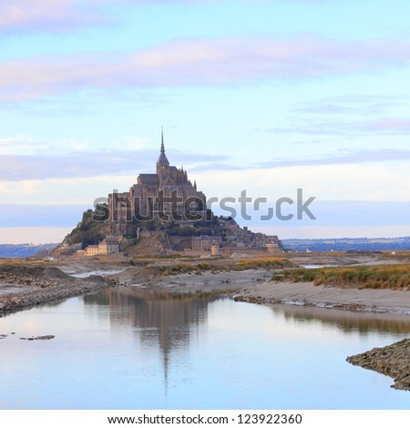 Mont Saint-Michel and reflection at low tide in Normandy, France - stock photo