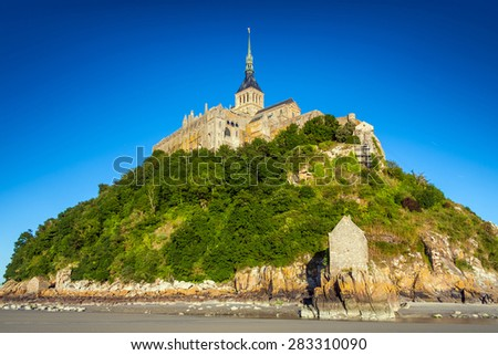 Mont Saint Michel at low tide Brittany, Basse, France, Europe - stock photo