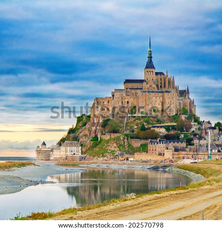 Mont Saint Michel city at sunset, Brittany,  France - stock photo