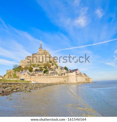 Mont Saint Michel city over sea tide,  France - stock photo