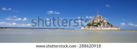 MONT SAINT MICHEL, FRANCE, JUNE 6.Panoramic view of famous Mont-Saint-Michel and green grass, taken on 6 June 2015, France, Europe.  - stock photo