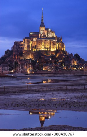 Mont Saint Michel (Saint Michael's Mount) at dusk in Normandy, France.