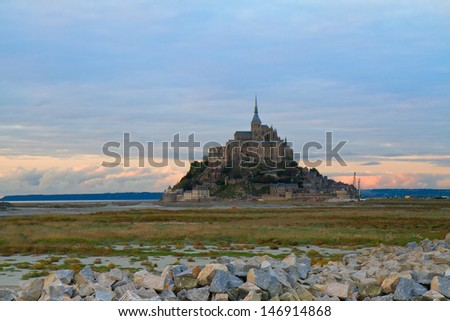 Mont St Michel city at sunset, Brittany,  France - stock photo