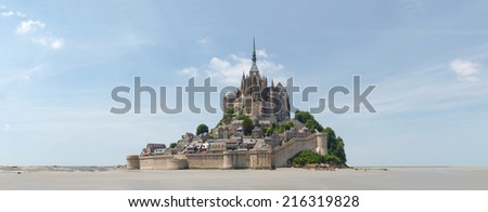 Mont St. Michel, France: Abbey of Mont St. Michel. View of the Abbey from the sands at low tide.  - stock photo