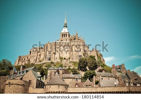 Mont St Michel touristic attraction of northern France in retro style - Famous historic place of French culture retro shoot - stock photo