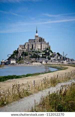 Mont St Michel world  famous historic landmark  in Normandy, France by the day - Famous  tourist  attraction in northern France - stock photo