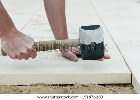 Montage of a concrete slab on terrace floor - stock photo