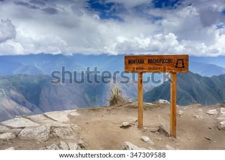 Montana Machu Picchu sign at roadside, Machu Picchu, Cusco Region, Urubamba Province, Machupicchu District, Peru - stock photo