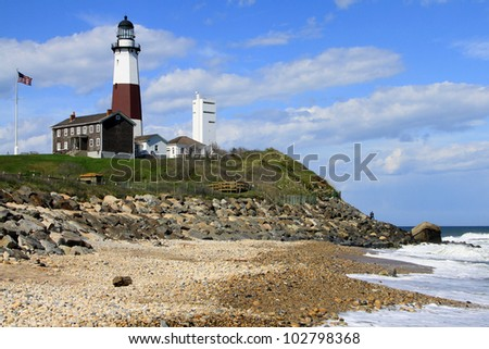 Montauk lighthouse on the Atlantic Ocean at the eastern tip of Long Island, New York.  It was commissioned by President Washington and built in 1796. - stock photo