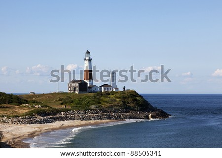 Montauk Point Lighthouse and beach from the cliffs of Camp Hero. Montauk Point, Long Island, New York - stock photo