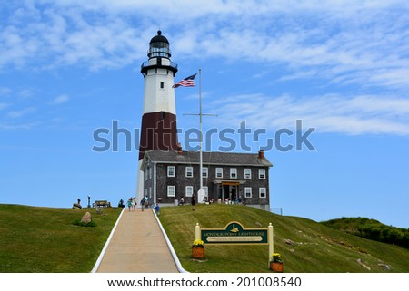 Montauk Point New York, USA - June 24, 2014: Visitors enjoying a summer day at Montauk Point Lighthouse at Montauk State Park in Long Island New York.  - stock photo