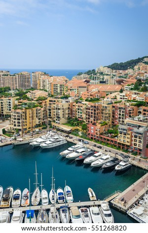 Monte Carlo harbour city panorama. View of luxury yachts and apartments in harbor of Monaco