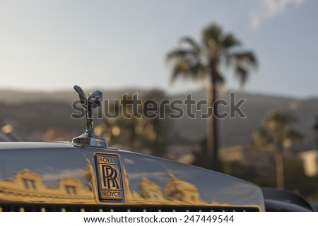 MONTE CARLO - MAY 24:Rolls Royce with famous winged emblem mascot ,parked in front of casino on May 24, 2013 in Monte Carlo. Monaco's climate and gambling facilities have made it recreation center . - stock photo