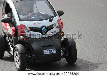 Monte-Carlo, Monaco - April 6, 2016: Electric Car Renault Twizy on Avenue d'Ostende in Monaco. Woman Driving an Electric Car Sharing Vehicles (Mobee) in the south of France - stock photo