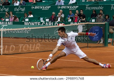 MONTE CARLO, MONACO. APRIL 18 2012 Novak Djokovic (SRB) in action during the second round match between Novak Djokovic (SRB) and Andreas Seppi (ITA)  at the ATP Monte Carlo Masters  . - stock photo