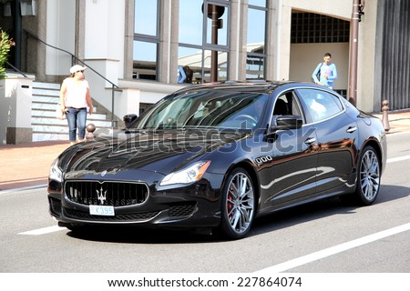 MONTE CARLO, MONACO - AUGUST 2, 2014: Black luxury sedan Maserati Quattroporte at the city street. - stock photo