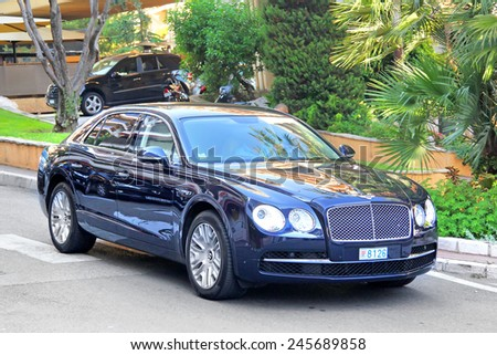 MONTE CARLO, MONACO - AUGUST 2, 2014: British luxury car Bentley Continental Flying Spur at the city street near the casino. - stock photo