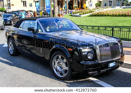 MONTE CARLO, MONACO - AUGUST 2, 2014: Motor car Rolls-Royce Phantom Drophead Coupe in the city street. - stock photo