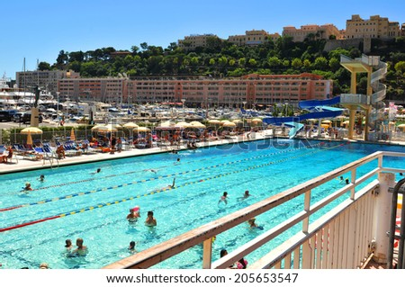 MONTE CARLO, MONACO - JULY 30, 2013: Luxurious swimming complex in Monte Carlo, major financial and touristic landmark in Europe.
