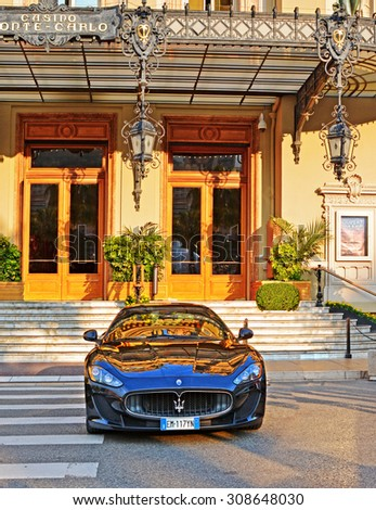 MONTE CARLO, MONACO -  JUN 02, 2015: Luxury car Maserati at the street near the famous Monte-Carlo Casino, Monaco. - stock photo