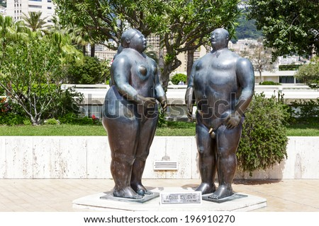 MONTE CARLO, MONACO - MAY 12, 2014: Bronze sculpture of Adam and Eve (1981) by Colombian figurative artist and sculptor Fernando Botero, located in gardens behind the Casino and Opera House