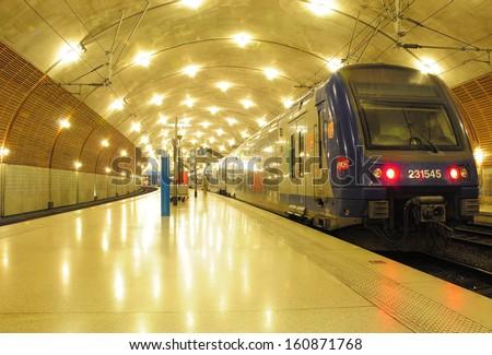 MONTE-CARLO, MONACO - MAY 24: Train stands at Monaco-Monte-Carlo railway station  on May 24, 2012 in Monte Carlo, Monaco.  - stock photo