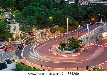 MONTE CARLO, MONACO - October 07, 2014: The Grand Hotel hairpin in Monte Carlo at night on October 07, 2014 in Monaco. Monte Carlo is host to the Formula One Monaco Grand Prix.  - stock photo