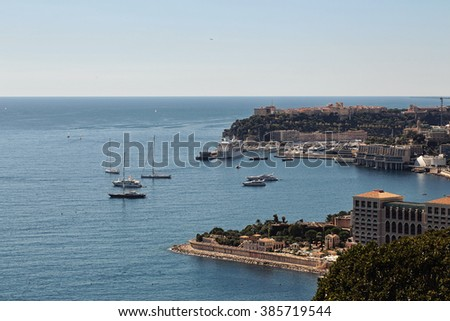 Monte Carlo, Monaco - September 20, 2015: city coastline sea port harbor shore yachts residential buildings view from mountains day time blue sky on seascape background, horizontal picture  - stock photo
