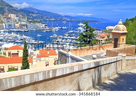 Monte Carlo town and harbor seen from the medieval walls of Monaco-ville, Monaco - stock photo