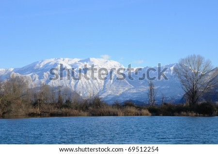 Monte Guglielmo (Brescia, Italy) snow covered early morning, seen from Torbiere del Sebino peat bog