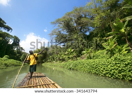 MONTEGO BAY, JAMAICA - FEBRUARY  11, 2015: Bamboo Rafting on the Martha Brae River, a popular tourist attraction in Jamaica. - stock photo